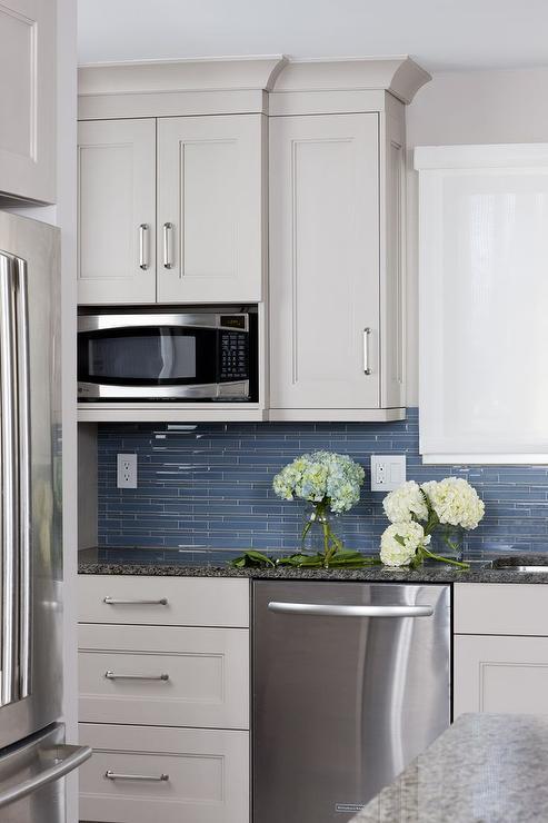 linear blue glass tile backsplash