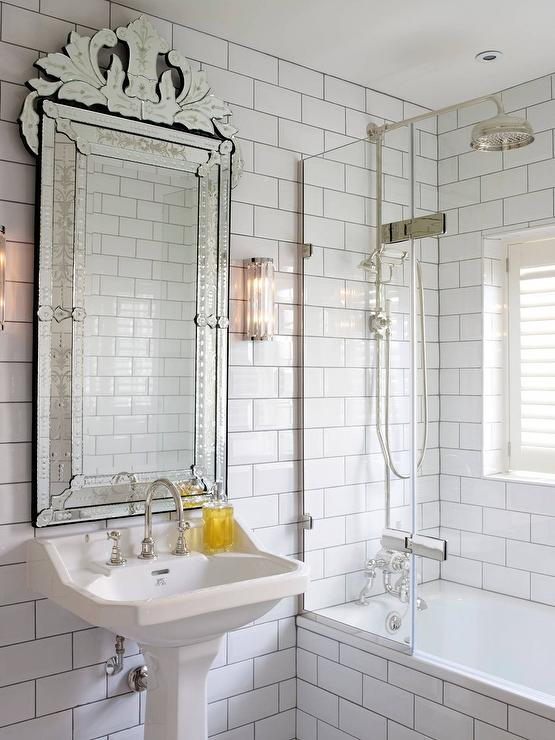 white subway tiles and dark grout