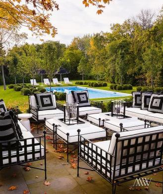 Wrought Iron Chairs Design Ideas Chic patio features wrought iron sofas  chairs and ottomans covered in  black and white cushions placed in front of the in ground pool