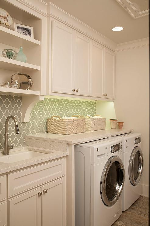 laundry room with gray arabesque tile