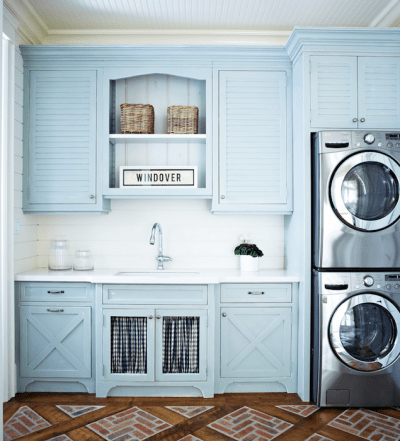 Country Laundry Room with Blue Paint and White Shiplap and Modern Appliances