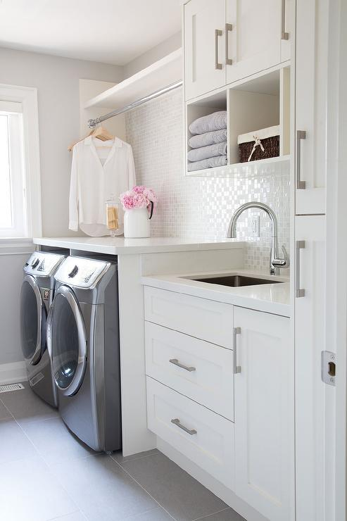 laundry room with white iridescent tile