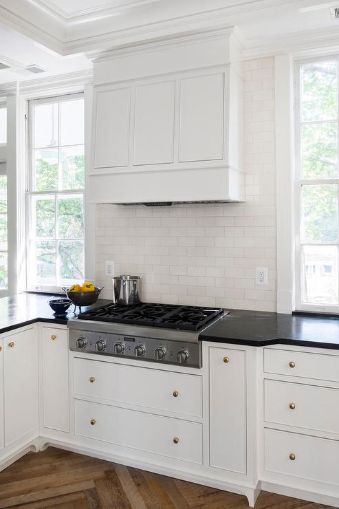 White Kitchen Cabinets With Brass Hardware And Black