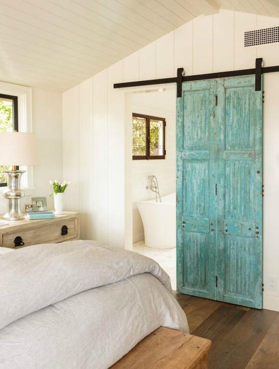 Turquoise Barn Door on Rails to Bathroom
