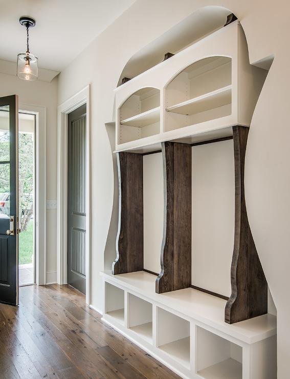 Mudroom With Paneled Walls And Shoe Cubbies Transitional