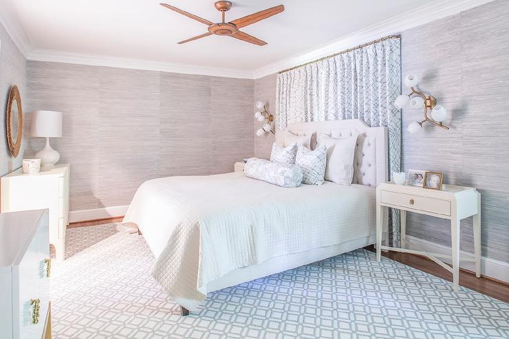 blue bedroom with curtains behind bed