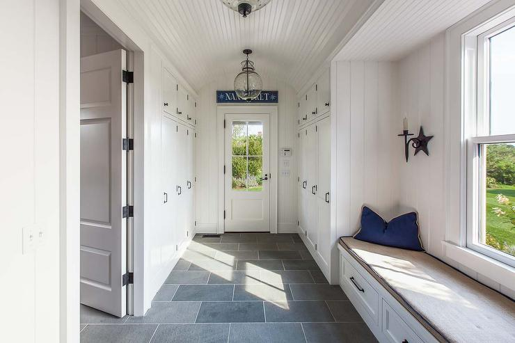 Long Cottage Mudroom With Beadboard Barrel Ceiling