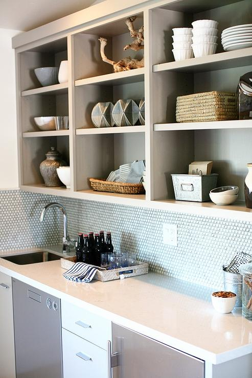 gray wet bar with white penny tile