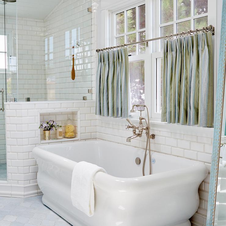 freestanding tub under window dressed
