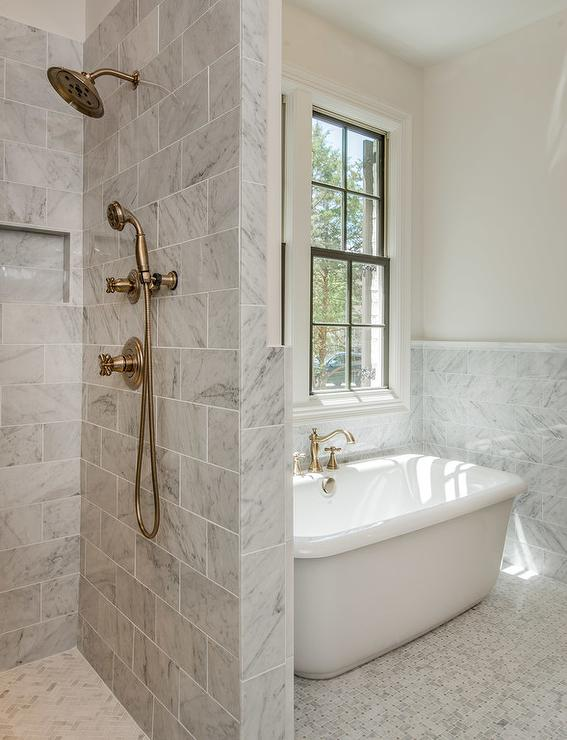 Gray Marble Bathroom With Shower Next To Tub