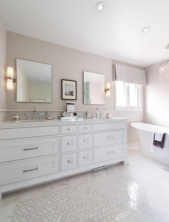 white and tan bathroom with white marble herringbone tiles