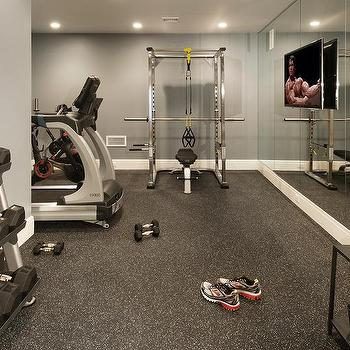 Bat Gym With Flat Panel Tv On Mirrored Walls