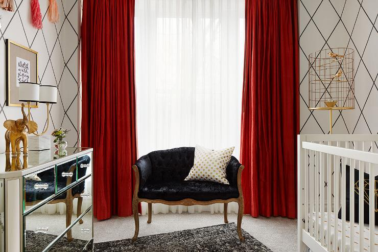 white nursery with red curtains
