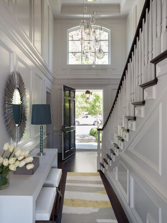 Long Two Story Foyer With Yellow And Gray Rug