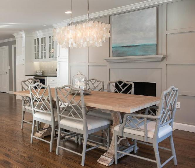 Amazing Dining Room Features A West Elm Large Rectangle Hanging Capiz Chandelier Illuminating Salvaged Wood Trestle Table Lined With Gray Bamboo