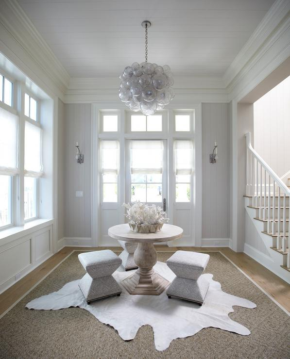 White And Gray Beach Cottage Foyer With Center Table Oly Studio Muriel Chandelier
