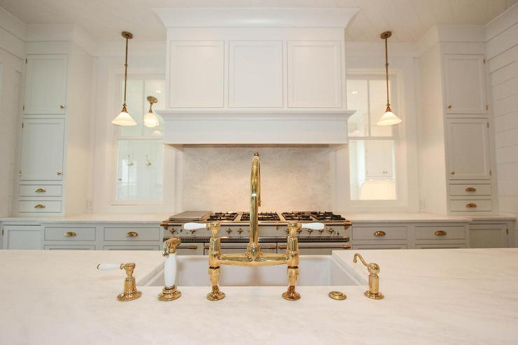 White Kitchen With White Honed Marble Counters And