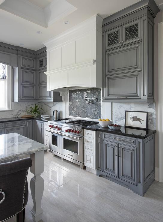 White Kitchen Hood With Dark Gray Mosaic Cooktop Backsplash Tiles Transitional Kitchen