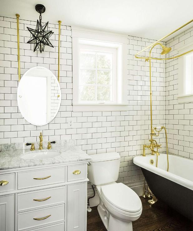 White And Gold Bathroom With Black Clawfoot Tub