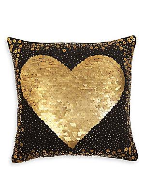gold and black heart sequined pillow
