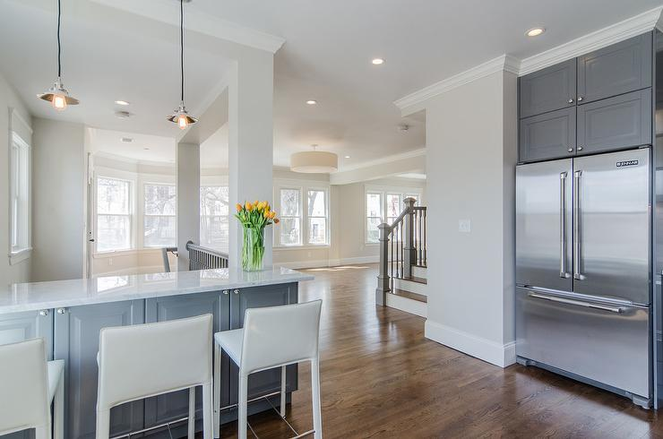 Gray Kitchen Peninsula With White Leather Counter Stools