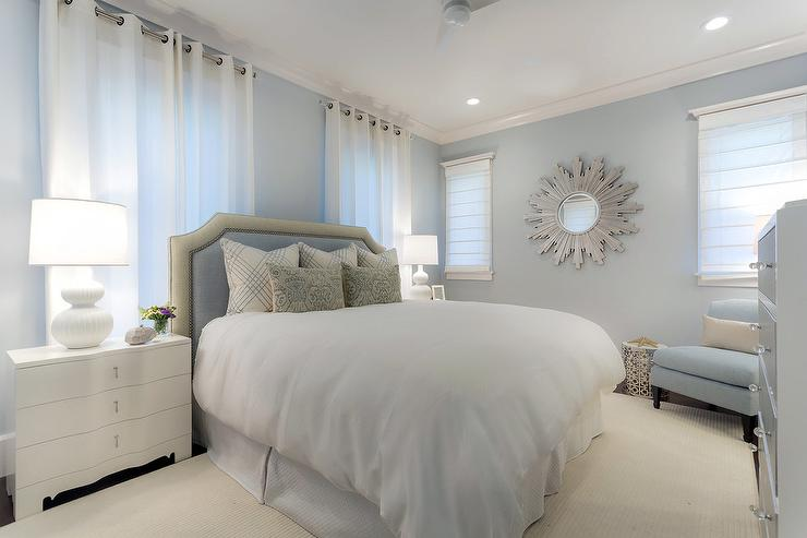 White And Blue Bedroom With Silver Sunburst Mirror Transitional Bedroom