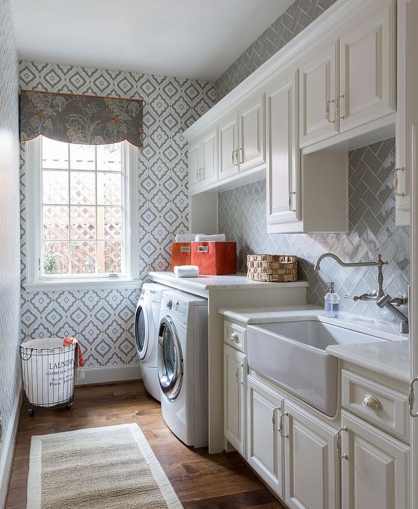 galley style laundry room with