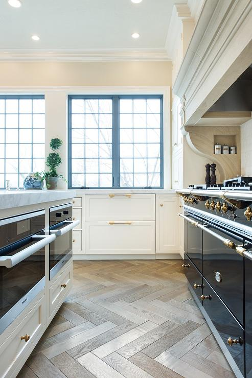 kitchen island with two microwave ovens