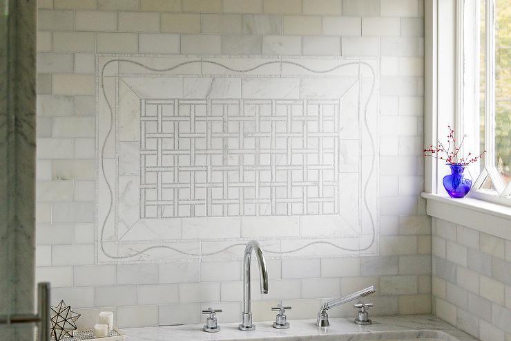 white marble basketweave tiles over tub