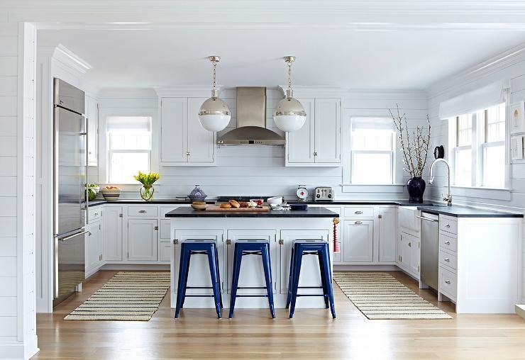 White Beach Bungalow Kitchen With Navy Blue Tolix Stools Cottage Kitchen