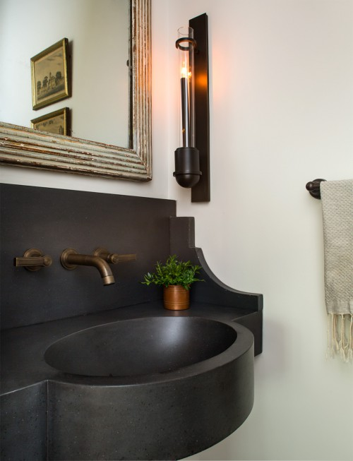 powder room with black wall mount sink