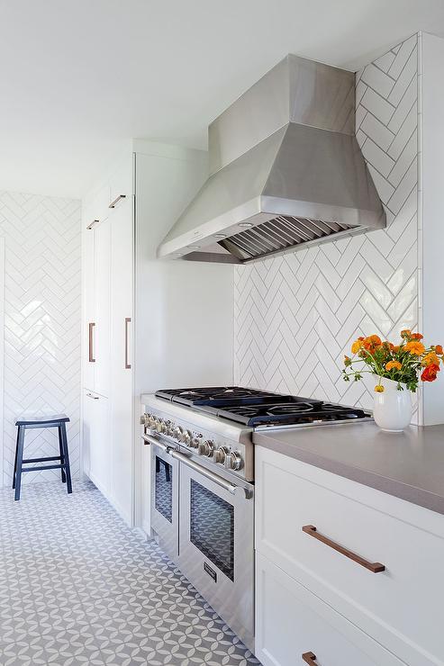 white herringbone tile kitchen floor