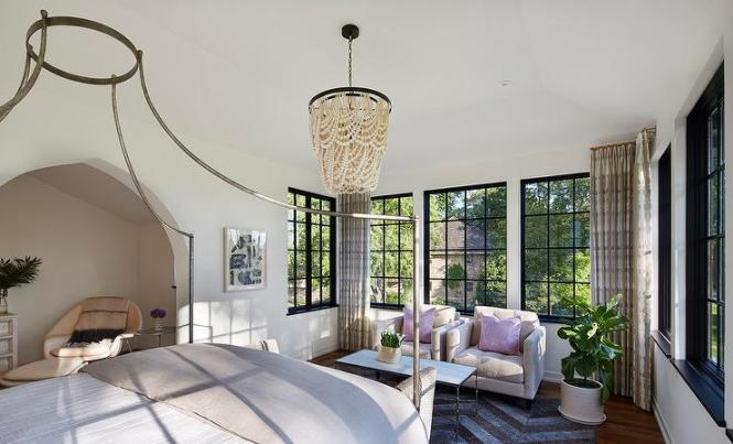 Small Bedroom Sitting Area With Cream Tufted Chairs And Lilac Pillows