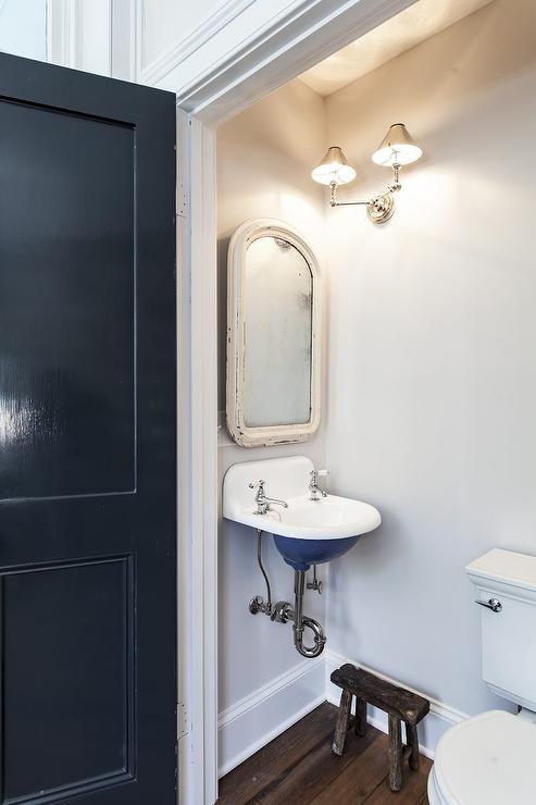 tiny vintage powder room with wall