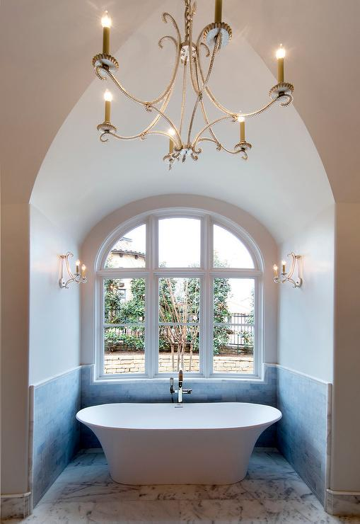 Gothic Nook With Bathtub And Oslo Sconces Transitional