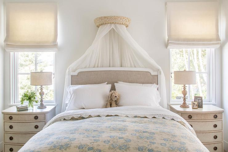 french gray linen bed with sheer canopy