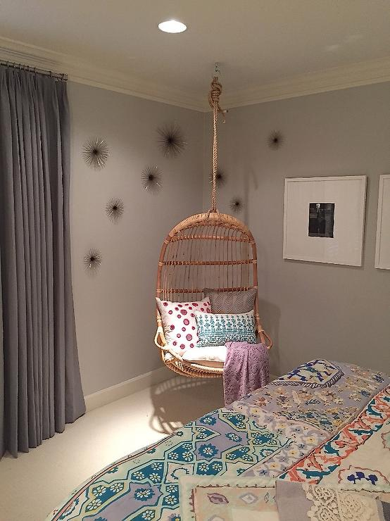 girl room with corner hanging rattan