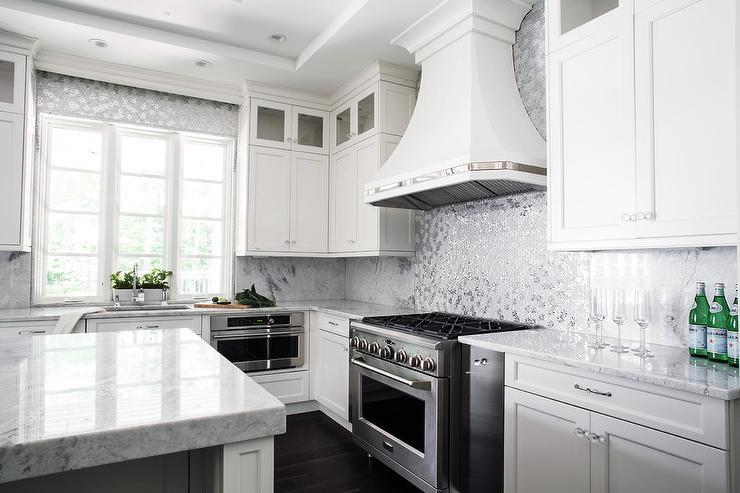Ivory And White Kitchen With Gray Metallic Tile Backsplash