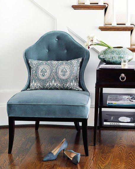 blue armless curved tufted chair