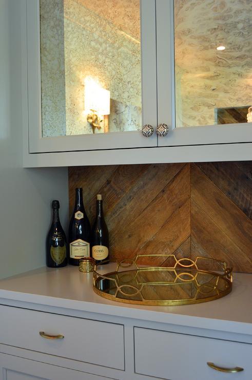 Antiqued Mirrored Bar Cabinets With Wood Herringbone
