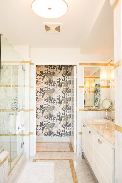 white marble tiles with gold inlay in