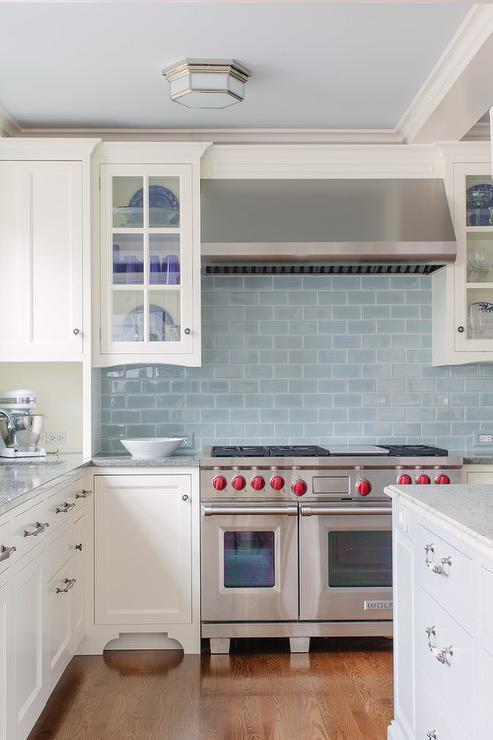 white kitchen cabinets with blue glazed