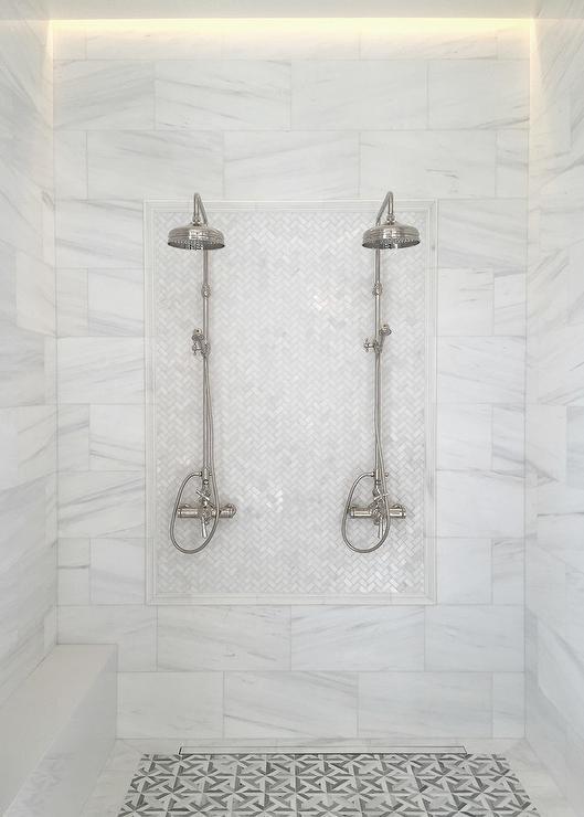 white marble herringbone shower tiles