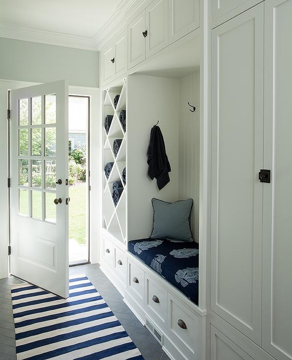 White And Blue Long Mudroom With Gray Herringbone Tile