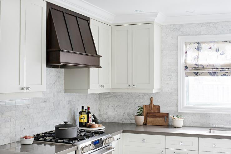 White Kitchen With Coffee Stained Kitchen Vent Hood
