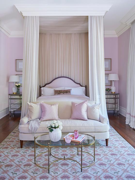 pink bed with sheer curtains