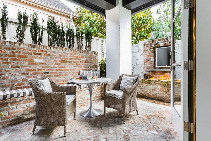 red brick patio with outdoor tv over