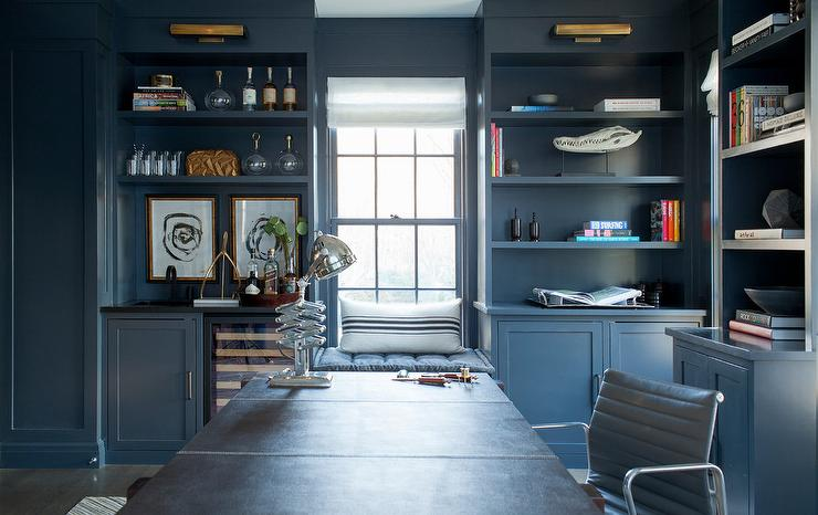Gray Built In Shelves With Brass Picture Lights