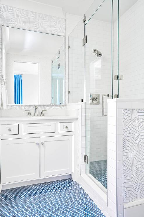white kid bathroom with blue penny tile