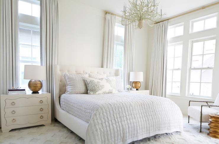 White Master Bedroom With Gold Lamps